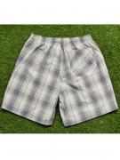 Комфортные домашние мужские шорты из хлопка в серо-бежевую клетку на...